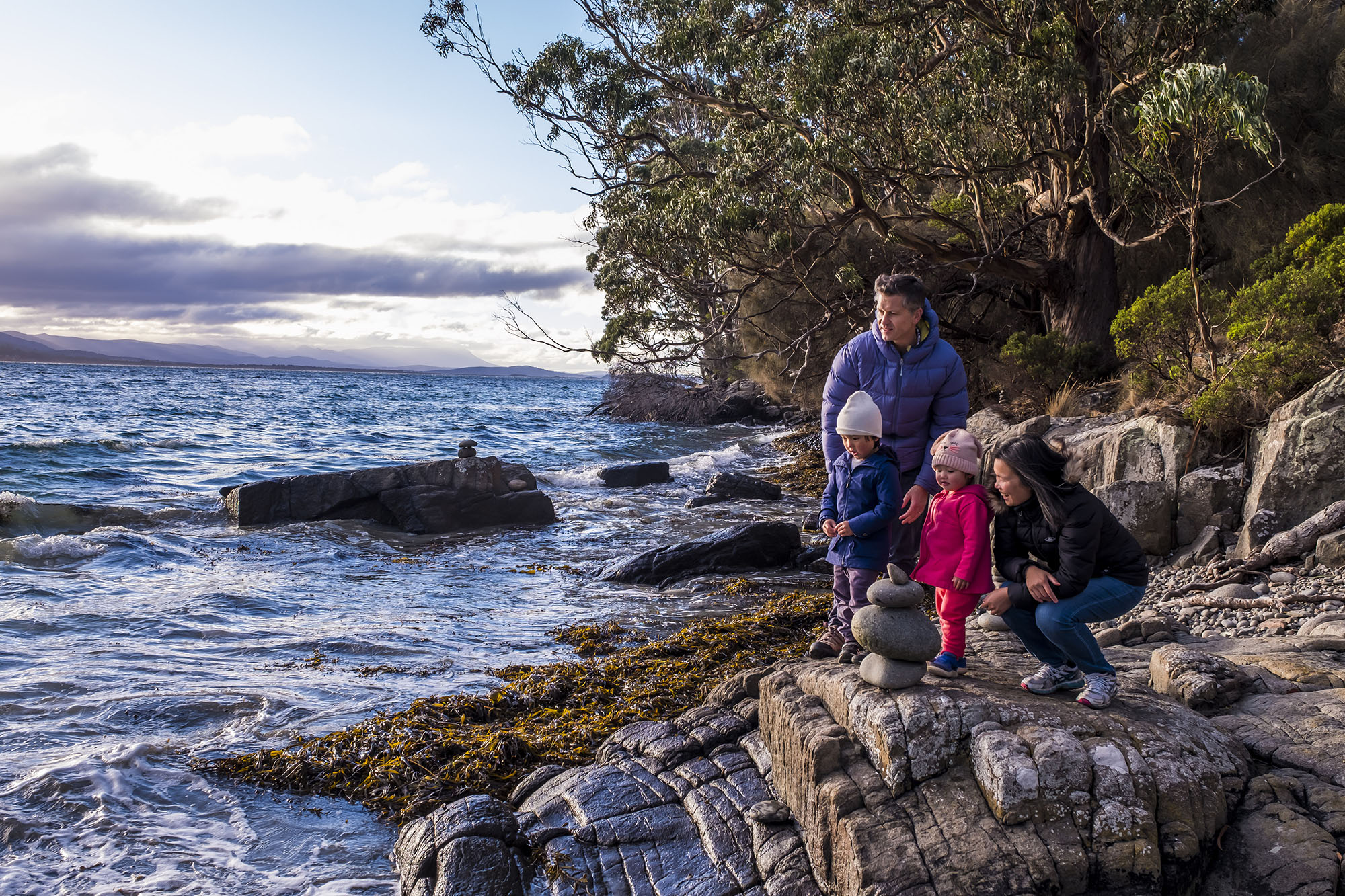 Young family at Grass Point, South Bruny National Park.