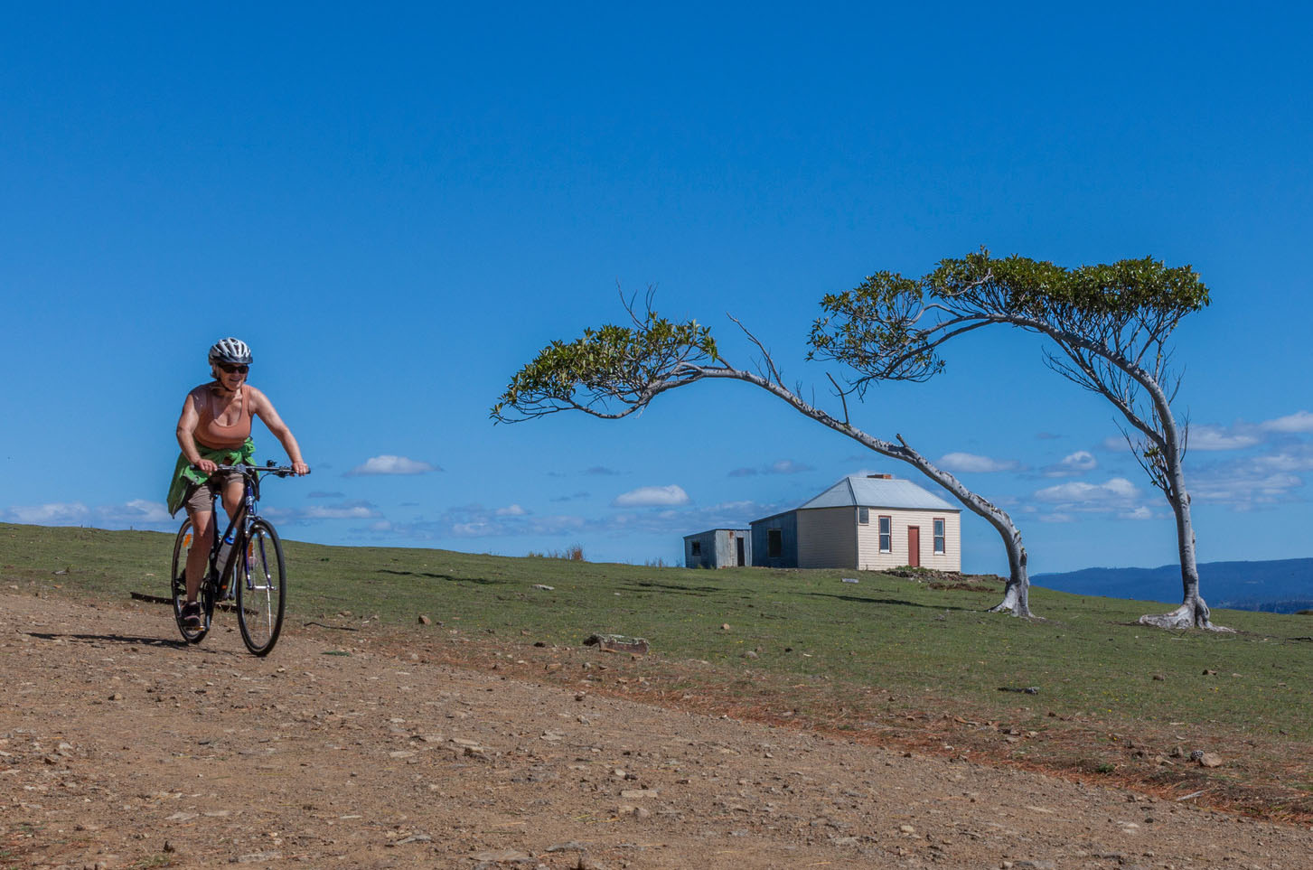 Cycling past Ruby Hunts Cottage, Maria Island National Park.
